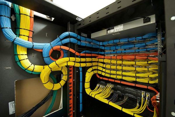 Though completely unrelated, let's take a moment to indulge the wiring-OCD in all of us. Oh the beauty of hundreds of well-organized, crimped network cables.