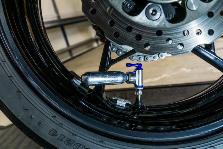 Though not without its downsides, a CO2 inflator is the most compact way to refill a tubeless motorcycle tire. Just keep in mind that you'll need multiple cartridges.